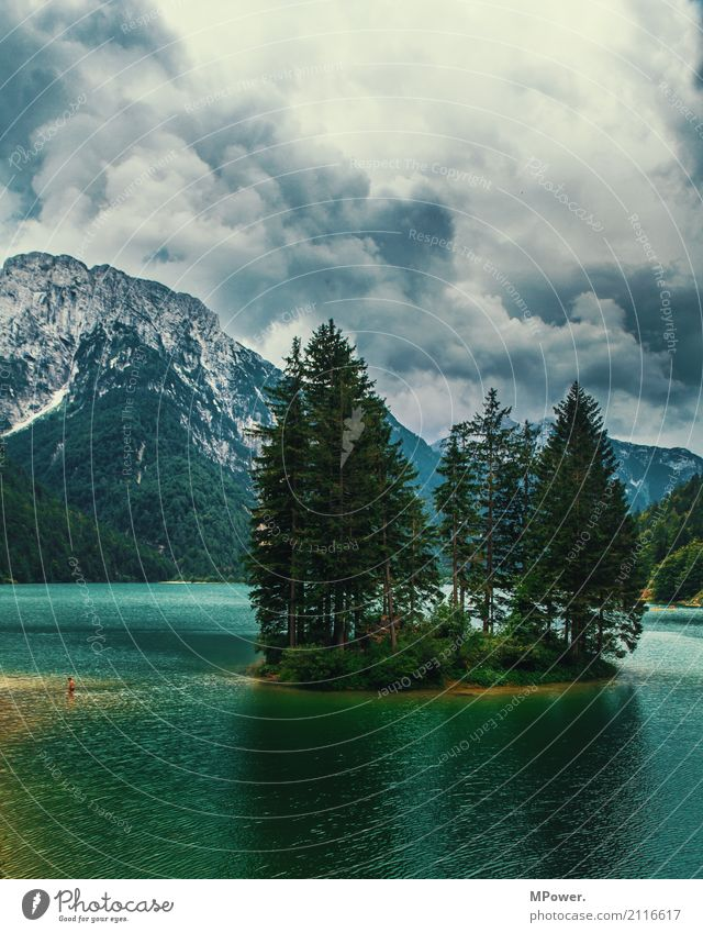 the lake of Ribles Environment Landscape Elements Clouds Storm clouds Bad weather Thunder and lightning Tree Forest Alps Mountain Peak Lakeside Esthetic Italy