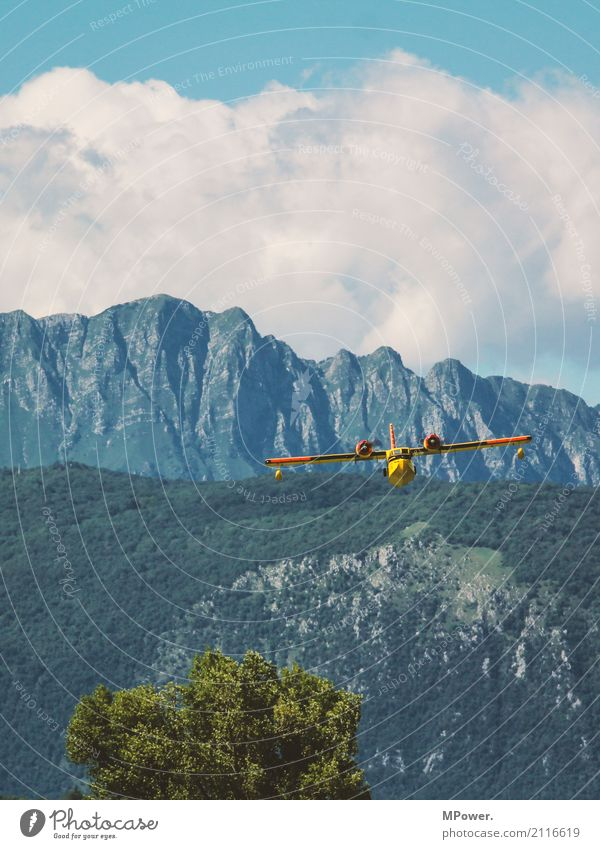 in low flight Environment Landscape Beautiful weather Tree Alps Mountain Peak Transport Means of transport Aviation Airplane Propeller aircraft Seaplane Flying