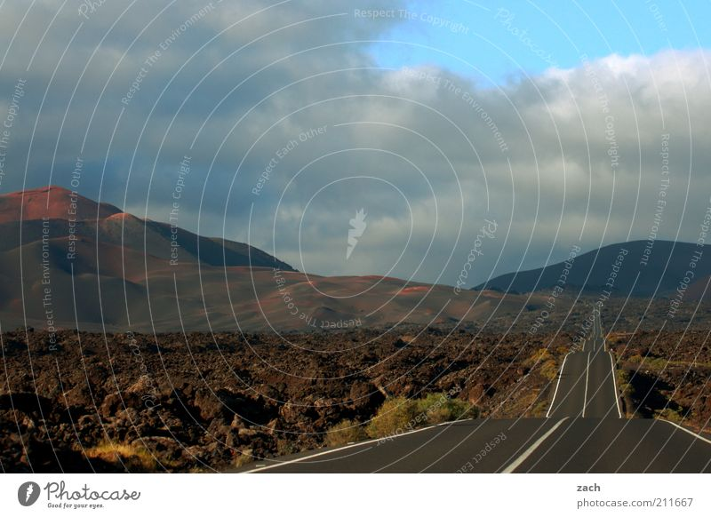 right through Trip Far-off places Landscape Sunrise Sunset Hill Mountain Fuego mountains National Park of Timanfaya Volcano Island Lanzarote Street