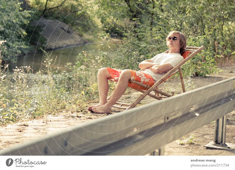 This is where I live | No. 009 Young man Youth (Young adults) Environment Summer Plant Brook Crash barrier Swimming trunks Sunglasses Deckchair Concrete Metal
