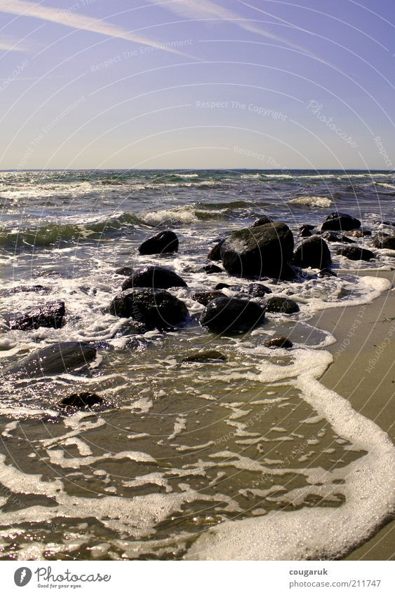 Nature Water Sky Ocean Beach Vacation & Travel Far-off places Stone Sand Landscape Coast Waves Environment Horizon Rock Tourism