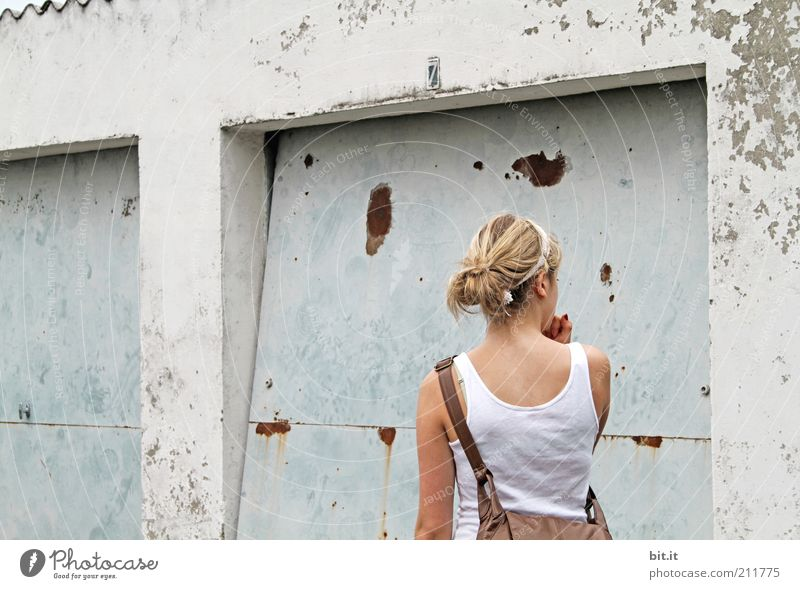 Human being Old Youth (Young adults) Summer Feminine Wall (building) Wall (barrier) Blonde Facade Concrete Stand Change T-shirt Manmade structures Hut