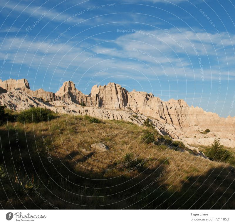 Creeping Shadow Landscape Sky Clouds Sunlight Summer Beautiful weather Warmth Grass Rock Mountain Badlands Dry Willpower Dependability Endurance Unwavering