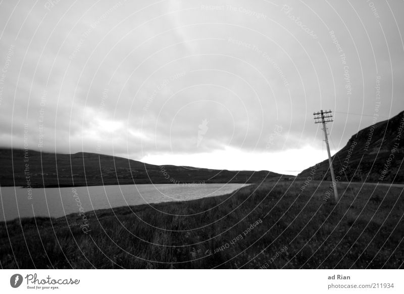 somber Nature Clouds Rain Grass Hill Lakeside Scotland Deserted Electricity pylon Dark Gloomy Stagnating Moody Black & white photo Copy Space top Cloud cover