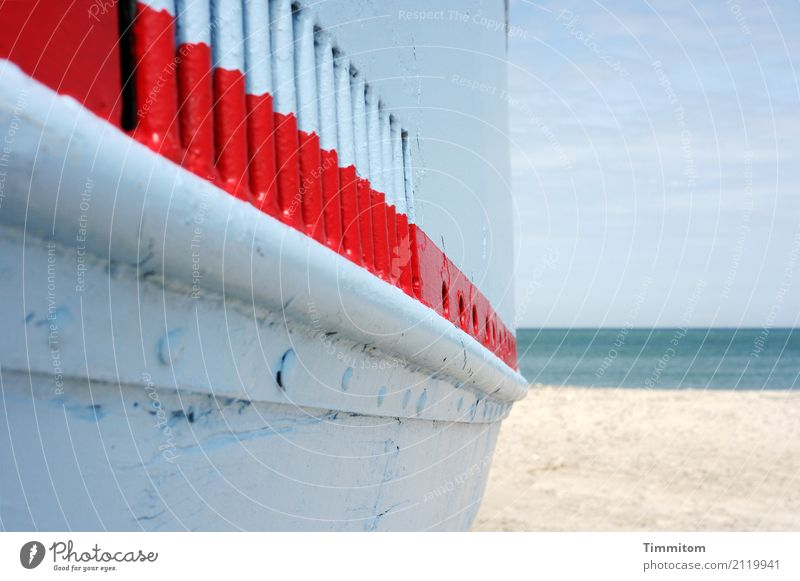 The red line. Vacation & Travel Environment Nature Elements Sand Water Sky Bad weather North Sea Navigation Fishing boat Wood Metal Lie Wait Esthetic Blue Red