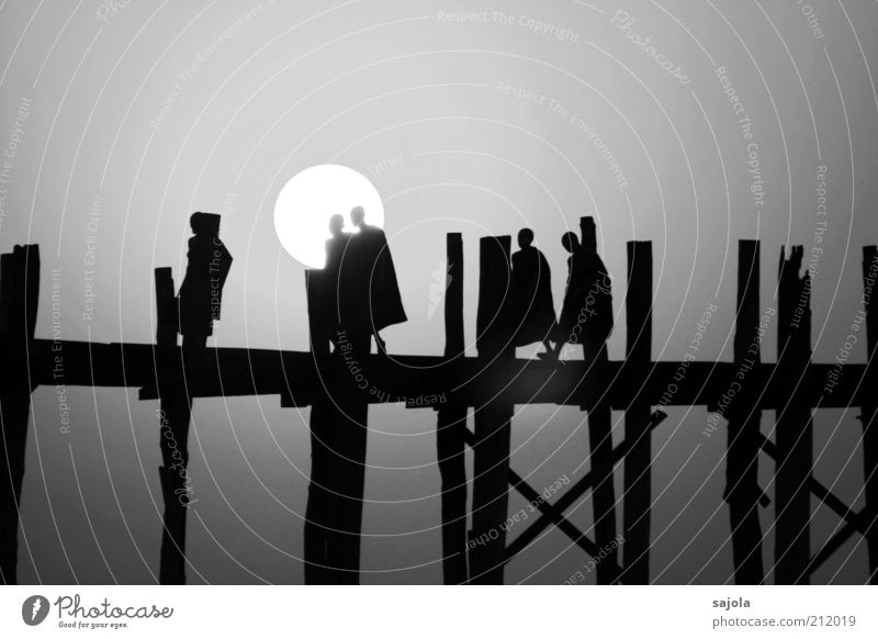 silhouettes of monks Vacation & Travel Tourism Human being Masculine Man Adults 5 Group Sun Amarapura Myanmar Asia South East Asia Bridge Wooden bridge