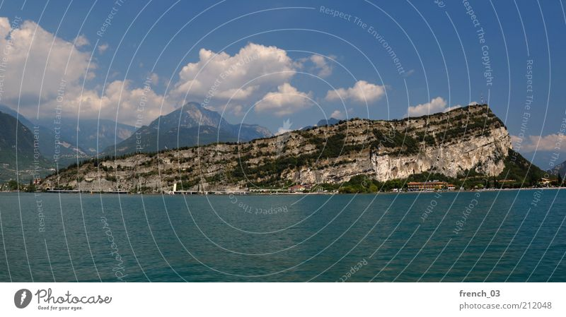 Nature Water Blue Summer Vacation & Travel Clouds Far-off places Freedom Mountain Stone Coast Lake Rock Alps Italy Peak