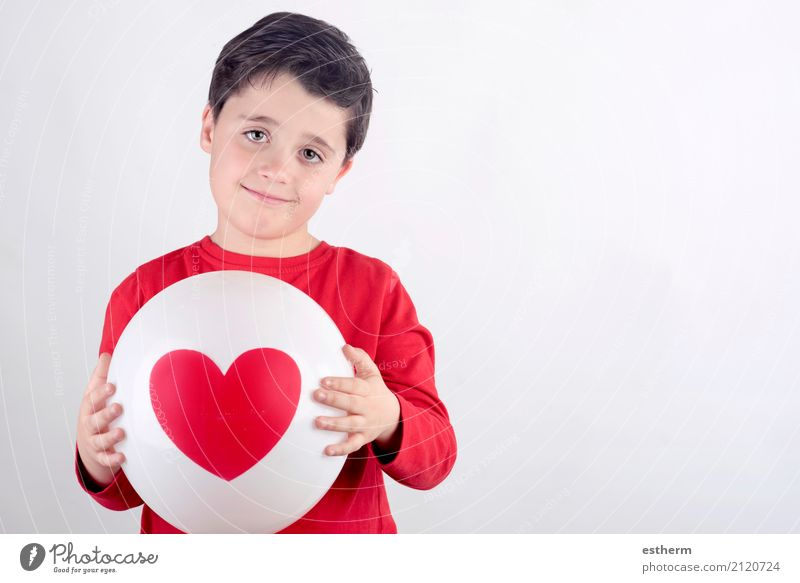 Smiling child with a heart Lifestyle Healthy Health care Feasts & Celebrations Valentine's Day Mother's Day Human being Masculine Child Toddler Boy (child)