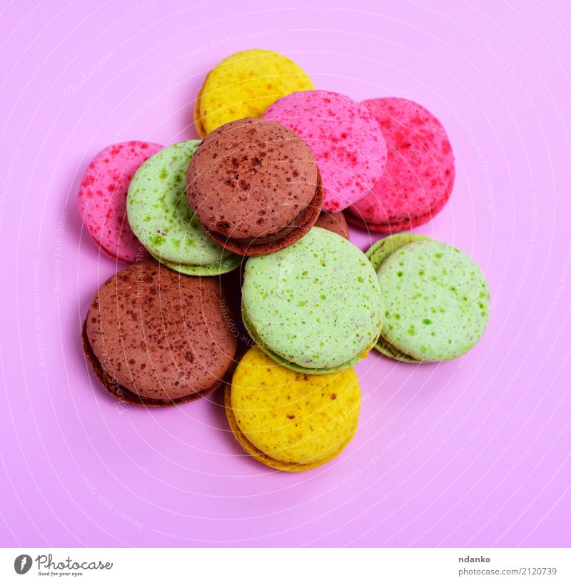 multicolored macarons Dessert Candy Gastronomy Bright Delicious Brown Yellow Green Pink Tradition colorful background Macaron sweet cake Baked goods biscuits