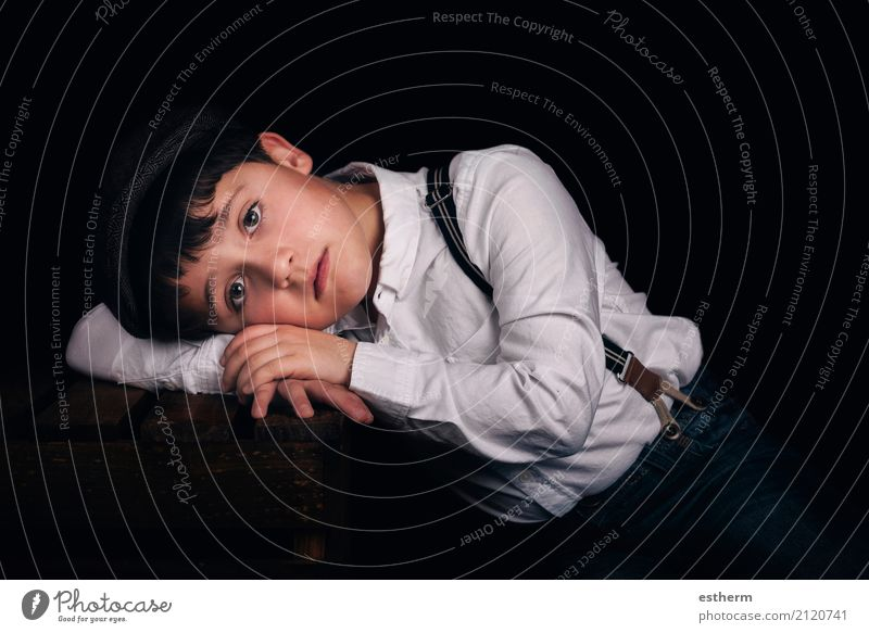 Pensive boy on black background Lifestyle Human being Masculine Child Toddler Boy (child) Infancy 1 3 - 8 years Cap Think Lie Sleep Sadness Gloomy Emotions
