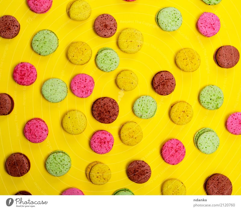 Colorful pastry macarons Dessert Candy Gastronomy Eating Bright Brown Multicoloured Yellow Green Pink Tradition colorful background Macaroni sweet cake