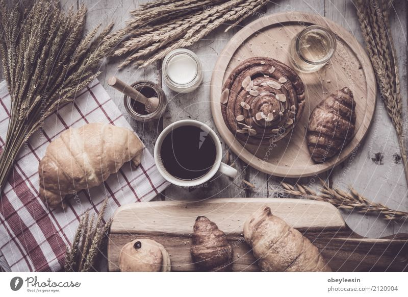 Coffee and fresh breads served for breakfast Old Dark Black Life Natural Wood Brown Vantage point Table Shopping Kitchen Beverage Cloth Hot Breakfast