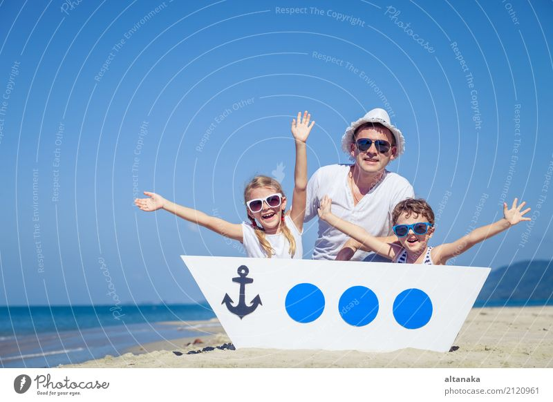 Father and children playing on the beach at the day time. Lifestyle Joy Leisure and hobbies Vacation & Travel Trip Adventure Freedom Cruise Summer Sun Beach