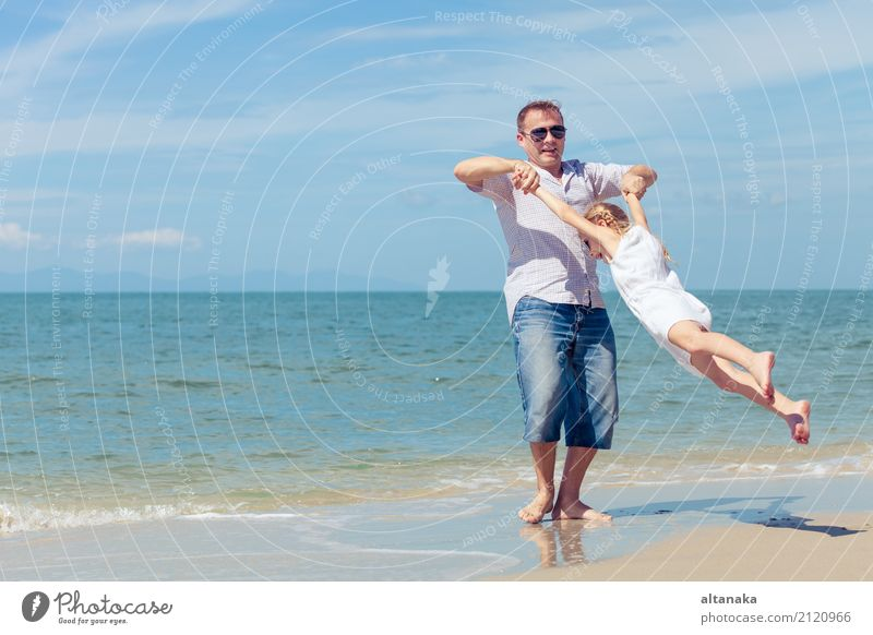 Father and daughter playing on the beach at the day time. Child Woman Nature Vacation & Travel Summer Sun Hand Ocean Relaxation Joy Beach Adults Life Lifestyle