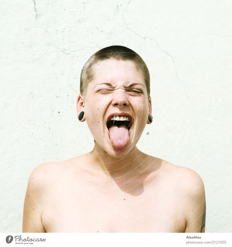 Young woman with short hair sticks out her tongue Lifestyle Style already Youth (Young adults) Face Tongue 18 - 30 years Adults Youth culture Subculture