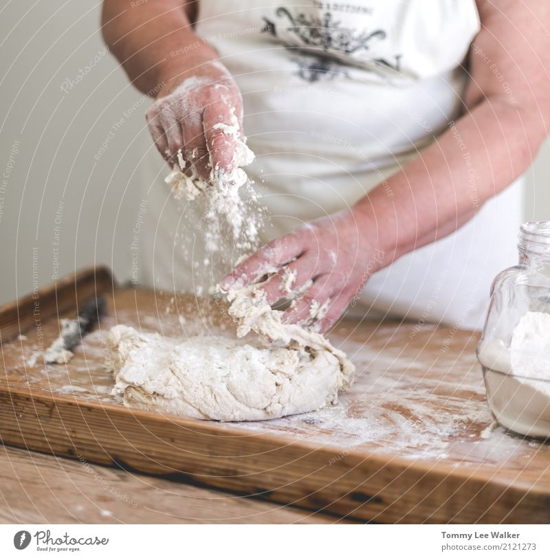 Senior woman mix dough Dough Baked goods Lunch Dinner Lifestyle Desk Table Kitchen Craft (trade) Woman Adults Grandmother Infancy Hand Village Wood Old Free