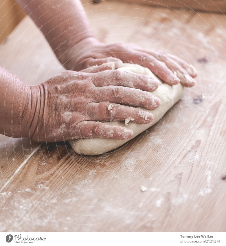 Senior woman makes dough Woman Old Hand Adults Life Lifestyle Wood Infancy Table Kitchen Village Tradition Grandmother Desk Craft (trade) Baked goods