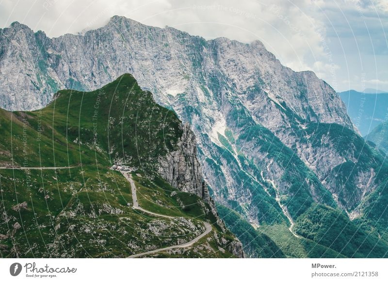 ...highest road in slovenia... Environment Clouds Beautiful weather Rock Alps Mountain Peak Fear of heights Slovenia Street Pass Wall of rock Tall Vantage point