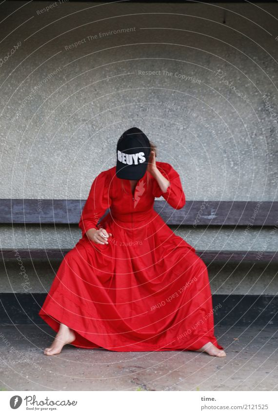 artistic pause Feminine Woman Adults 1 Human being Artist Stage play Actor Wall (barrier) Wall (building) Bench Dress Barefoot Cap Characters To hold on Smoking