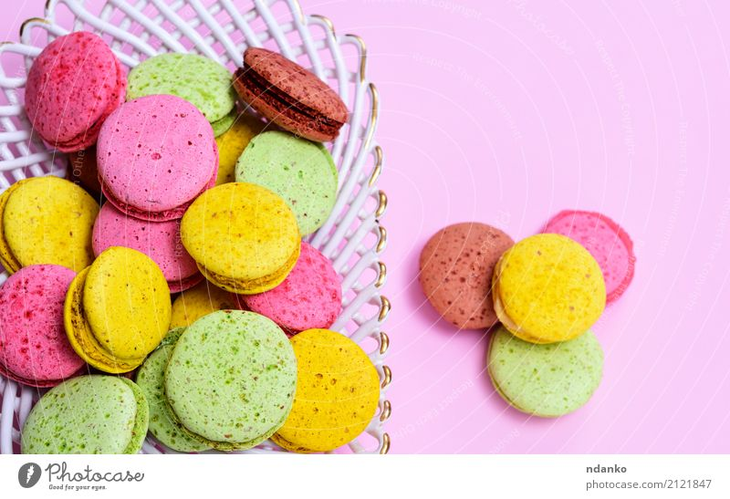 macarons multicolored Dessert Candy Plate Gastronomy Eating Bright Delicious Brown Yellow Green Pink Tradition Macaron colorful background sweet cake