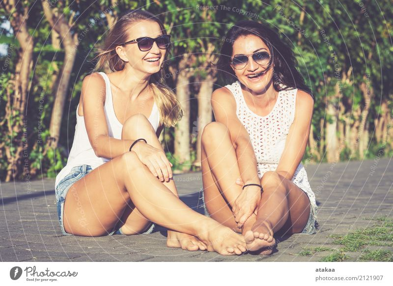 Pretty beautiful girl friends in sunglasses having fun. Human being Woman Vacation & Travel Summer Beautiful White Joy Face Adults Street Lifestyle Funny Love