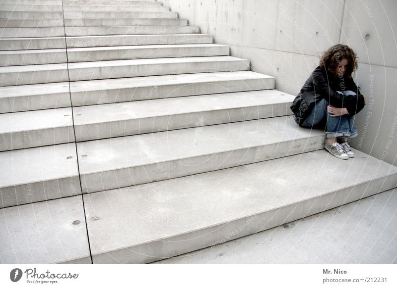 solitude Feminine Woman Adults Manmade structures Wall (barrier) Wall (building) Stairs Curl Black Calm Sadness Concern Lovesickness Longing Loneliness