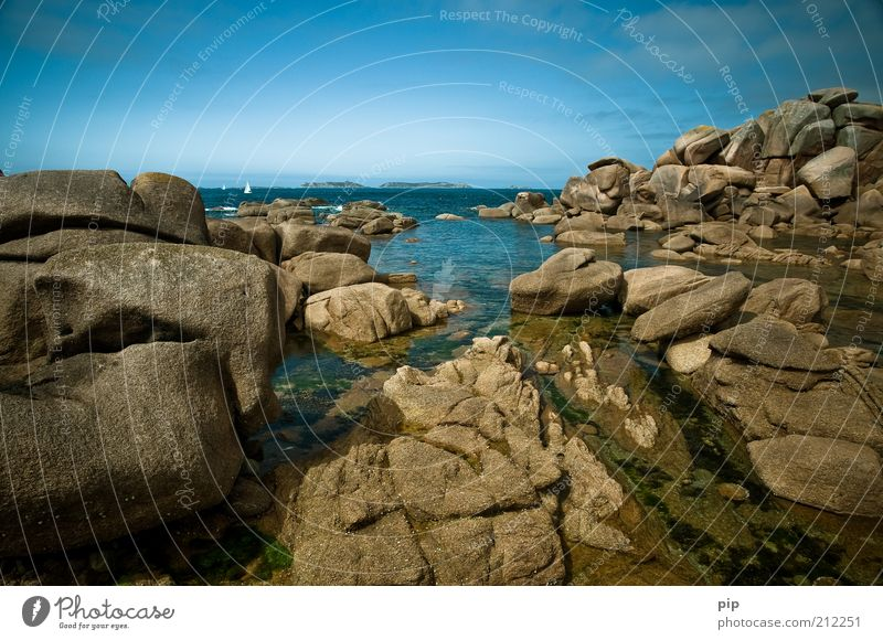 sail Nature Water Sky Rock Coast Bay Reef Ocean Stone Blue Brown Horizon Vacation & Travel Far-off places Wet Colour photo Multicoloured Exterior shot