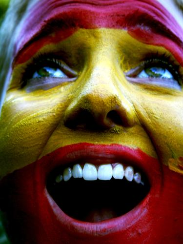 Spain Young woman Youth (Young adults) Face Scream Yellow Red Colour photo Exterior shot Day Portrait photograph Facial painting Teeth Enthusiasm Joy Fan