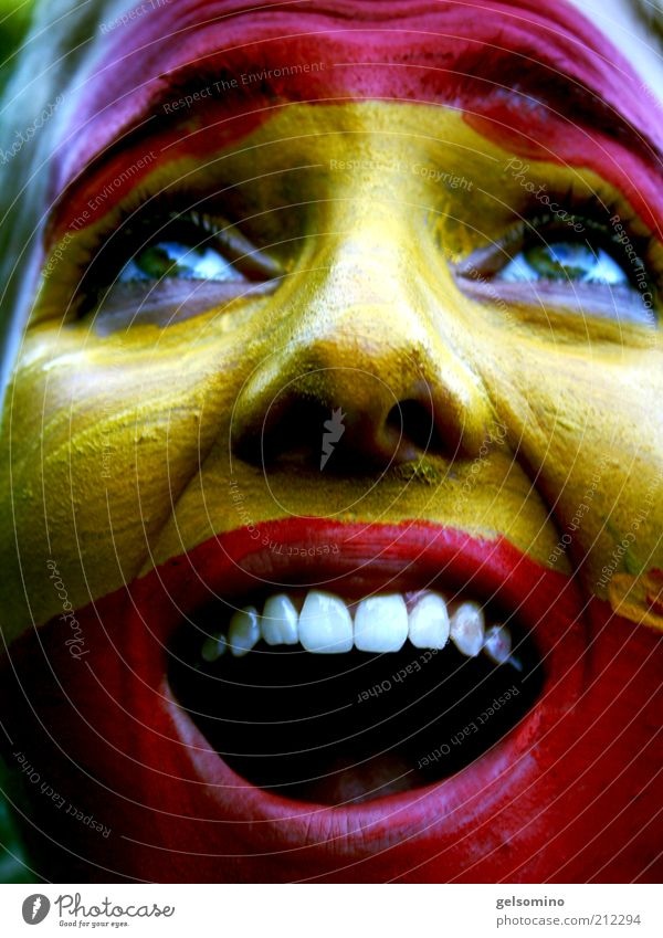Youth (Young adults) Red Joy Face Yellow Teeth Young woman Scream Fan Applause Enthusiasm Human being Woman Portrait photograph Spanish Facial painting