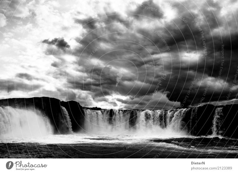 Godafoss Environment Landscape Water Sky Clouds Storm clouds Weather Bad weather Rock Canyon Waves River bank Brook Waterfall Gray Black White Iceland Power