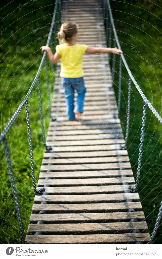 Human being Child Blue Girl Yellow Playing Legs Infancy Blonde Back Going Leisure and hobbies Walking Bridge Jeans To hold on