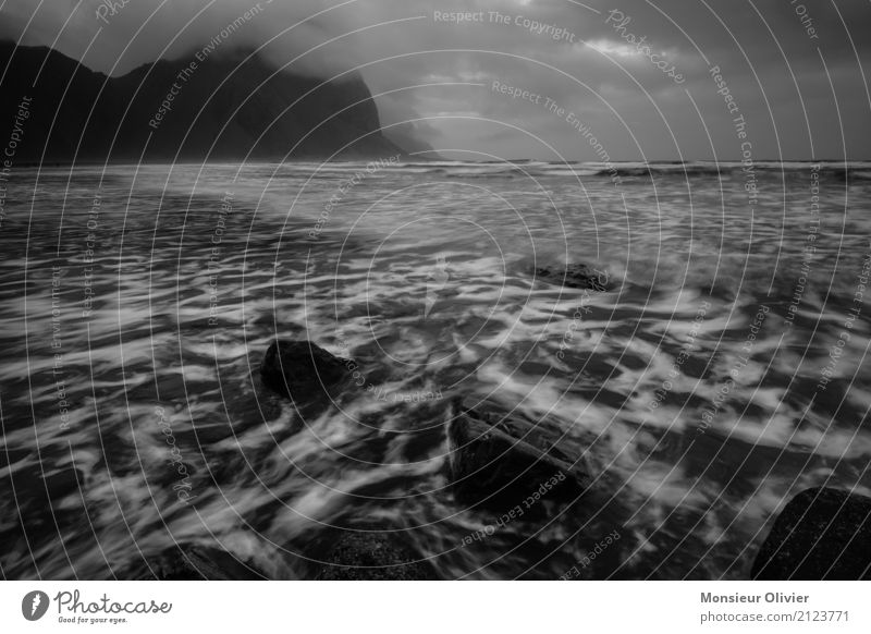 Low clouds on Iceland's coast Clouds Autumn Winter Mountain Waves Coast Adventure Aggression Vacation & Travel Dark Structures and shapes Movement gout Water