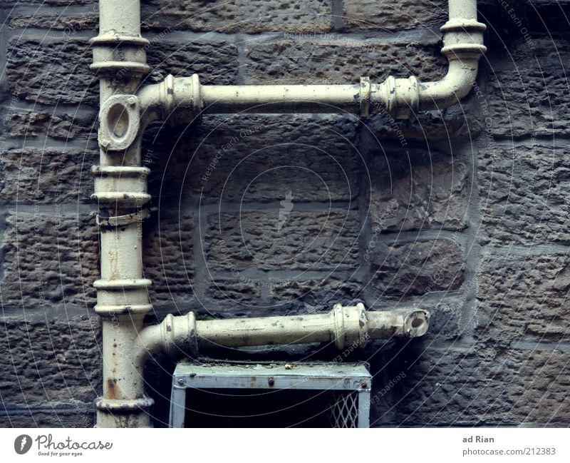 abundance Wall (barrier) Wall (building) Eaves Orderliness Colour photo Exterior shot Detail Deserted Stone wall Conduit Iron-pipe Transmission lines Connection