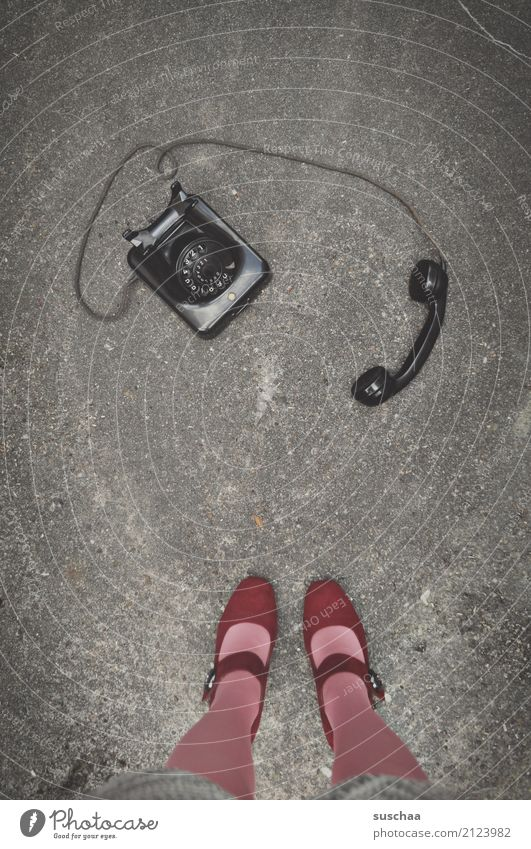 make a phone call Woman Legs feet High heels Stockings Street Stand Asphalt Telephone Analog Retro Old bakelite phone Old fashioned Former Communicate