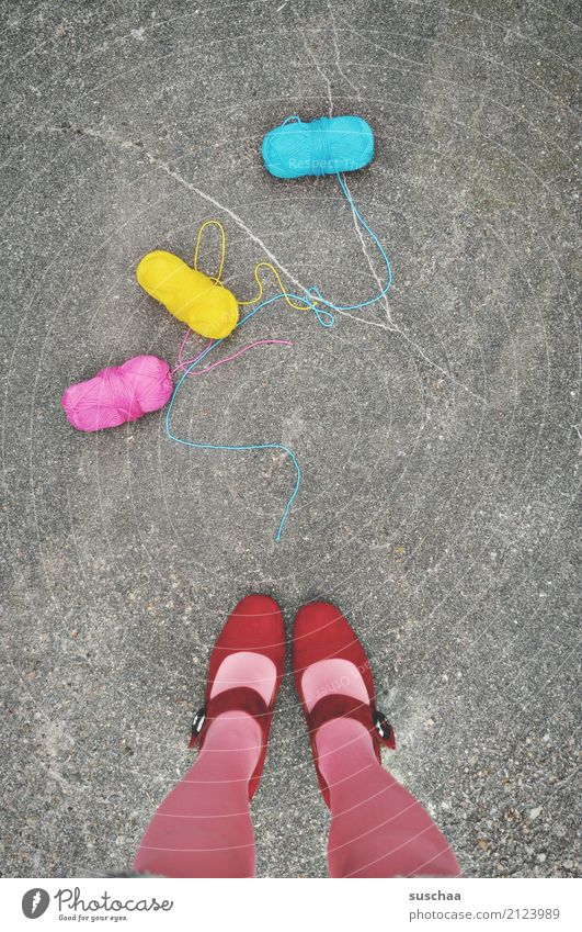 lost the thread ... Wool Ball of wool Handcrafts 3 Cyan Magenta Yellow Multicoloured Street Asphalt feet Legs Stand Footwear Red Fall down Doomed Surrealism