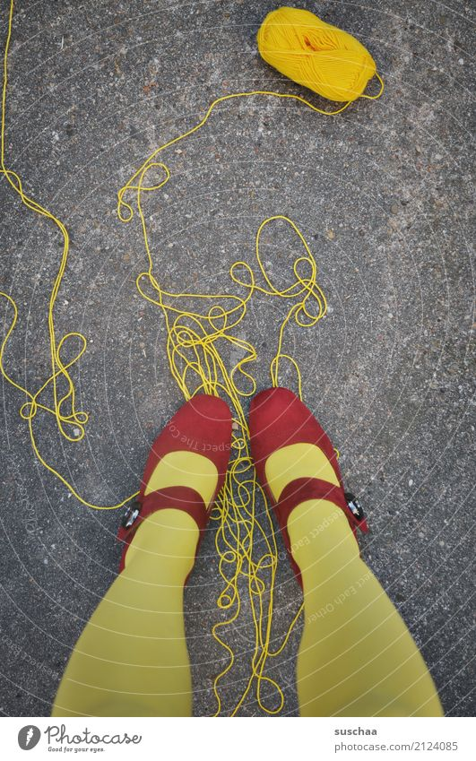too much thread String unwound Wool Ball of wool Handcrafts be on it Feet Legs Stand Yellow Red Footwear red shoes Asphalt Surrealism