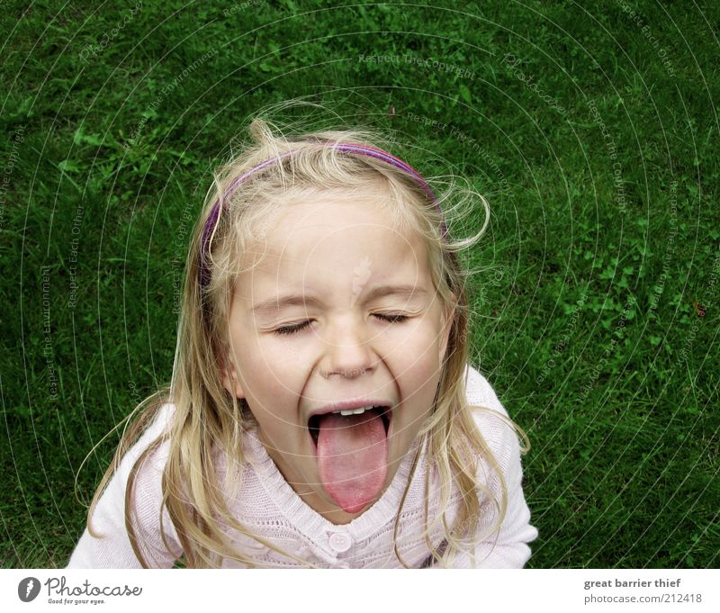 girl child tongue meadow Human being Child Girl Infancy Head Hair and hairstyles 1 3 - 8 years Scream Romp Sadness Cry Green Puzzle Grumble Meadow Wind Tongue