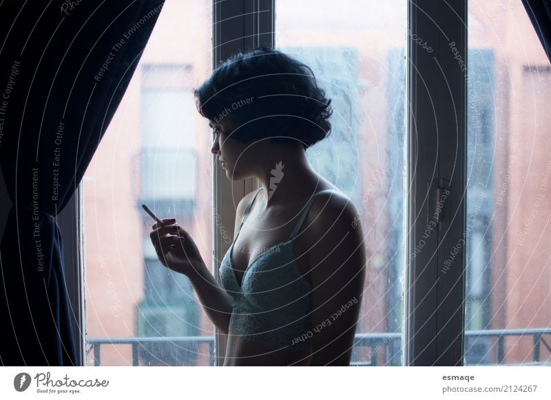 Girl smoking Lifestyle Elegant Style Window Feminine Young woman Youth (Young adults) Observe Think Smoking Sadness Eroticism Natural Curiosity Rebellious Blue
