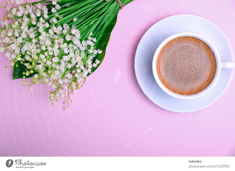 cup of coffee with foam Breakfast To have a coffee Beverage Coffee Espresso Cup Mug Table Restaurant Flower Bouquet Blossoming Fresh Above Pink Black White