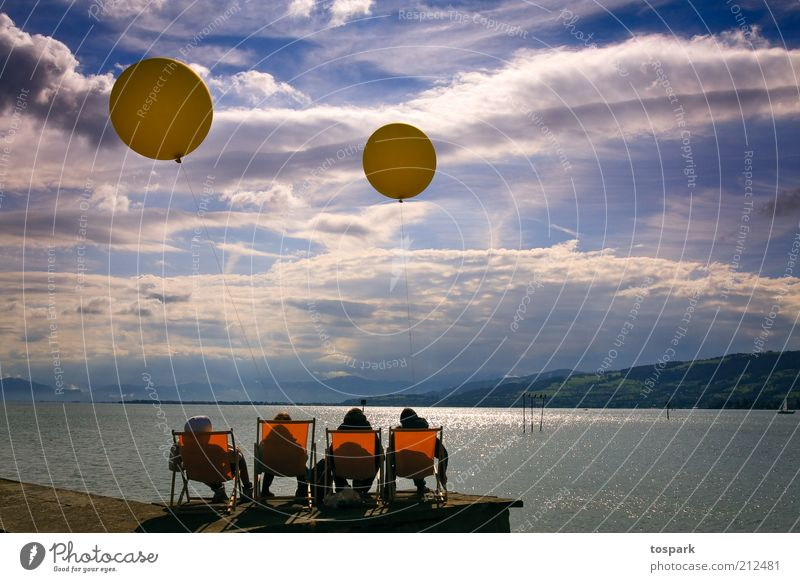 Afternoon at the lake Contentment Relaxation Calm Playing Human being Friendship 4 Water Sky Clouds Summer Beautiful weather Lake Lake Constance Balloon Observe
