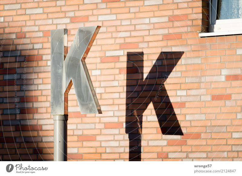 K K Wall (barrier) Wall (building) Characters Town Brown Black Silver Letters (alphabet) Light and shadow Pylon House wall Exterior shot Detail Deserted Day