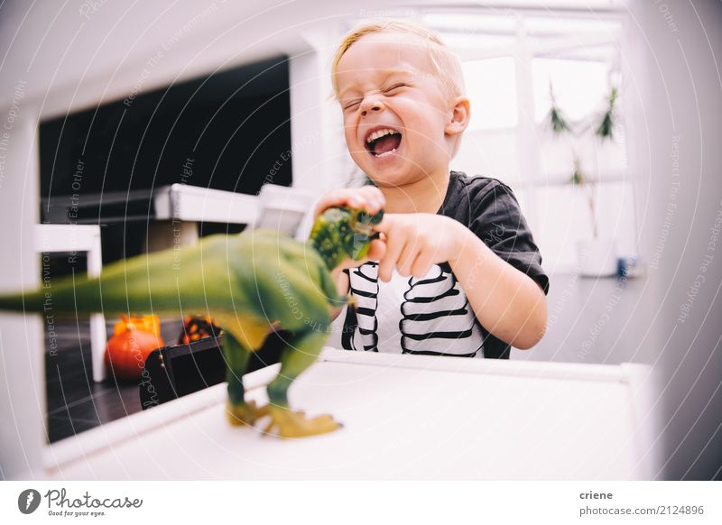 Little boy playing with dinosaur toys Child Joy Funny Boy (child) Laughter Playing Happy Leisure and hobbies Smiling Toys Home Scream Offspring Dinosaur