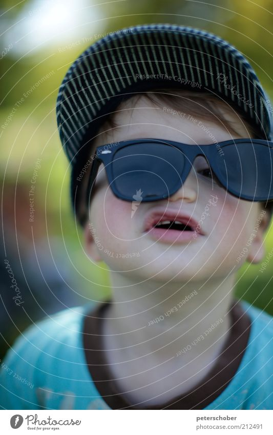sunglasses Playing Summer vacation Human being Child Boy (child) Head 1 1 - 3 years Toddler Looking Leisure and hobbies Joy Uniqueness Infancy Sunglasses