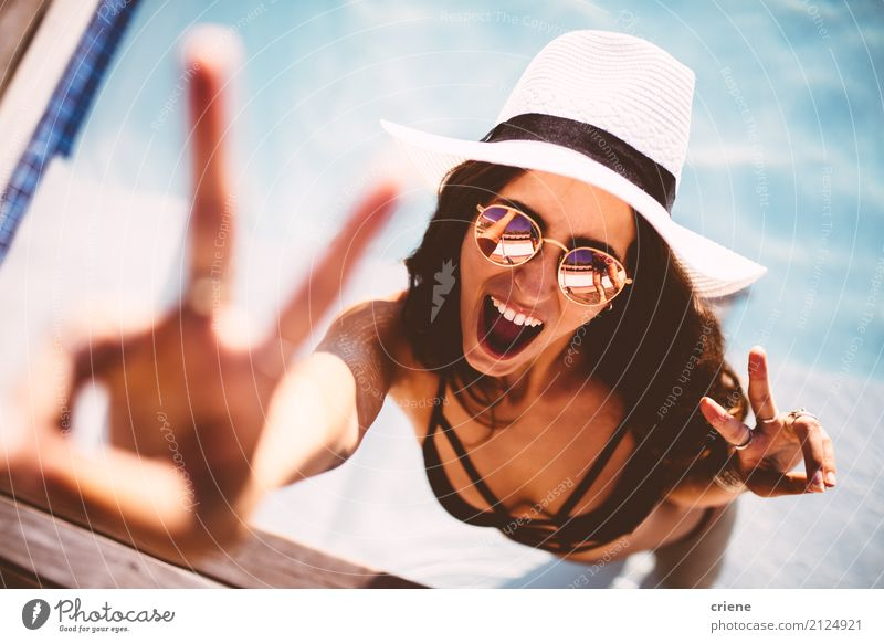 Happy young woman showing peace sign and looking at camera Lifestyle Joy Swimming pool Leisure and hobbies Vacation & Travel Freedom Summer Human being Feminine