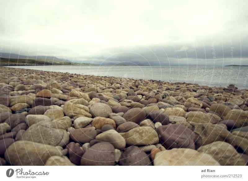 Water Ocean Beach Clouds Far-off places Movement Stone Rain Environment Horizon Infinity Idyll To enjoy Storm Bizarre Eternity