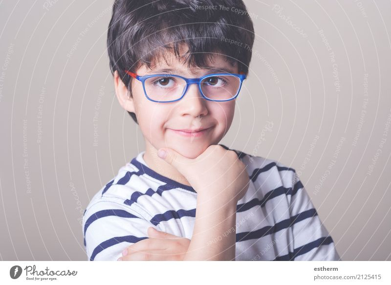Happy boy with glasses Human being Child Joy Life Lifestyle Funny Boy (child) School Think Contentment Infancy Smiling Happiness Friendliness Eyeglasses