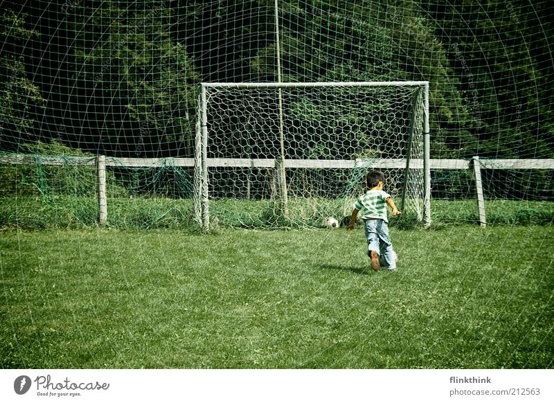 Boy playing football Leisure and hobbies Playing Soccer Vacation & Travel Summer Sports Ball sports Football pitch Human being Masculine Child Boy (child)