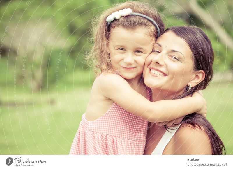 Happy mother and daughter playing in the park Human being Child Woman Nature Summer Beautiful Joy Face Adults Lifestyle Funny Love Family & Relations Small