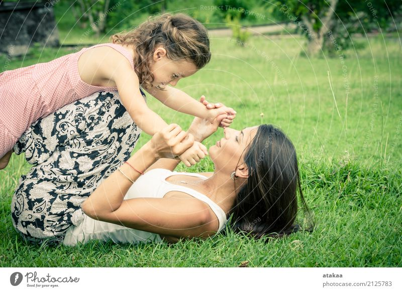 Happy mother and daughter playing in the park Lifestyle Joy Beautiful Face Leisure and hobbies Playing Vacation & Travel Summer Child Human being Baby Woman