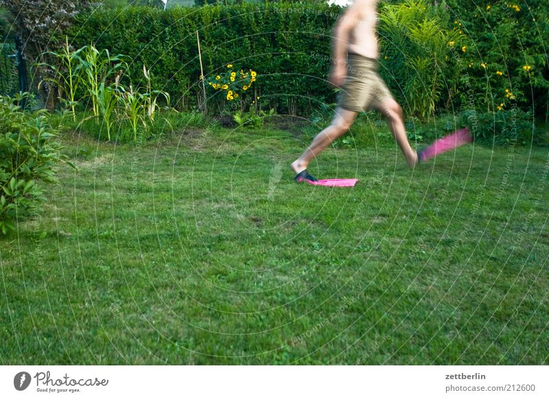 One more step... Joy Human being Man Adults Plant Grass Going August Water wings Colour photo Lawn Running Walking Green space Garden Motion blur Headless